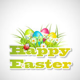 Eggs in grass and text happy easter Royalty Free Stock Photography