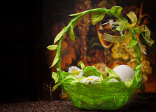 Eggs in green basket Royalty Free Stock Photo