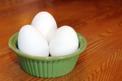 Eggs in a green bowl Royalty Free Stock Photos
