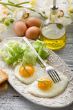 Eggs with green salad Royalty Free Stock Photography