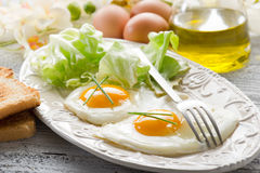 Eggs with green salad Stock Images
