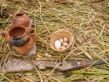 Eggs, Gun, Pottery Royalty Free Stock Photos