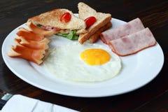 Eggs  ham and  hot dog on dishware. Stock Photography