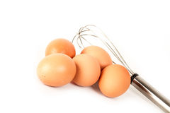 Eggs and hand beater. Brown eggs and hand beater Royalty Free Stock Image