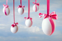Eggs hanged on the ribbons Royalty Free Stock Images