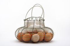 Eggs in hanging basket Royalty Free Stock Photos