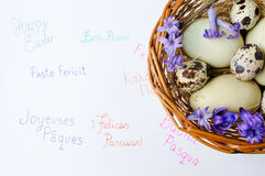 Eggs and Happy Easter note. In different languages stock photo
