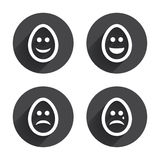 Eggs happy and sad faces signs. Easter icons Royalty Free Stock Photography
