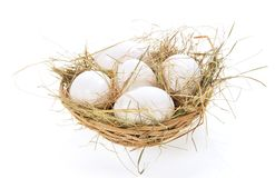Eggs, hay in a bast basket Royalty Free Stock Image