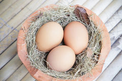 Eggs in hay and pottery Royalty Free Stock Photography