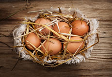 Eggs in hay Stock Photo