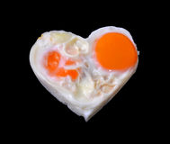 Eggs, heart black background Stock Photography