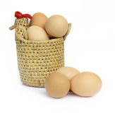 Eggs in hen basket Stock Photos