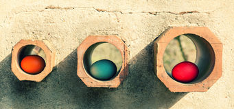 Eggs in holes Royalty Free Stock Photography