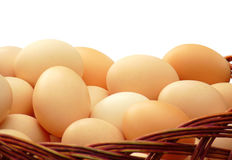 Eggs In A Wicker Basket Isolated Stock Photo