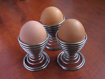 Eggs In Metal Spiral Eggcup Royalty Free Stock Photography