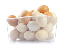 Eggs In Plastic Box On White Background Stock Photo