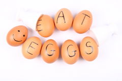 Eggs with an inscription EAT EGGS Royalty Free Stock Image