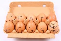 Eggs with an inscription EAT EGGS Stock Photography