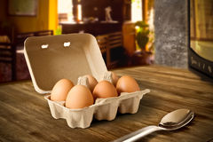Eggs In a Kitchen. Eggs in a recycle package on a pantry in a kitchen Stock Photography