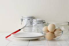 Eggs on kitchen counter. Eggs and bowl on kitchen counter Royalty Free Stock Images