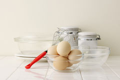 Eggs on kitchen counter. Eggs and bowl on kitchen counter Stock Images