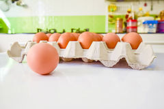 Eggs in kitchen. Group of eggs put on white table in the kitchen. ready for cooking Royalty Free Stock Images