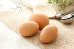 Eggs with kitchen utensils Royalty Free Stock Image