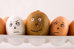 Eggs and kiwi Stock Photography