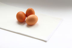 Eggs and knife Stock Photos