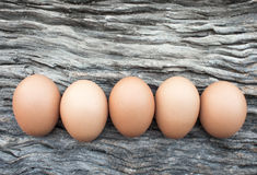 Eggs laid on wooden floor Royalty Free Stock Photo