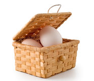 Eggs lay in a woven basket Royalty Free Stock Photography
