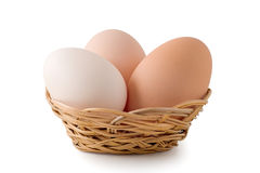 Eggs lay in a woven basket Royalty Free Stock Images