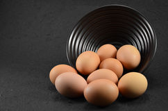 Eggs leave the cup. And black background Stock Images