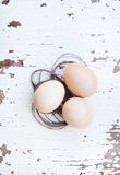Eggs lie on an old white table Royalty Free Stock Photo