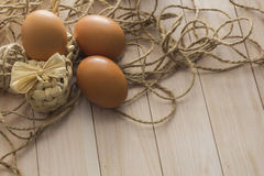 Eggs lie on a wooden table Royalty Free Stock Photo