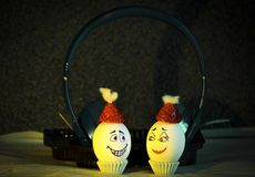 Eggs in listening music stock photography
