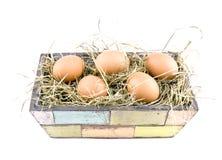 Eggs lying on hay in flowerpot Royalty Free Stock Photos