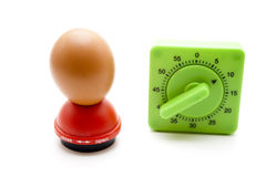 Eggs mandrel with egg and time Scolding clock Stock Photography