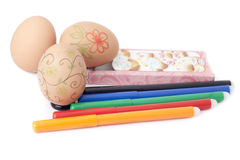 Eggs and markers  . Eggs and markers for coloring eggs Royalty Free Stock Photo