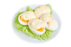 Eggs with mayonnaise. On green lettuce leaf Stock Images