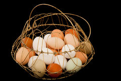 Eggs in Metal Wire Basket Royalty Free Stock Photography