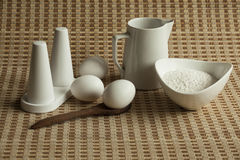 Eggs, milk and flour on table mat. Stock Photos