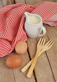Eggs with milk and forks on wooden table. Eggs with milk and forks on wooden background stock photography