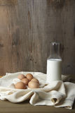 Eggs and milk on kitchen counter Stock Photos