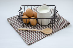 EGGS AND MILK. Protein breakfast is a good, Eggs and milk in basket on the white table Royalty Free Stock Image