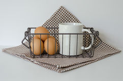 EGGS AND MILK. Protein breakfast is a good, Eggs and milk in basket on the white table Stock Image