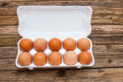 Eggs in molded carton. On wooden background Royalty Free Stock Image