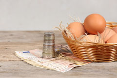 Eggs and money Stock Image