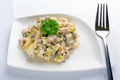 Eggs and mushrooms salad with leek and red onion Stock Photo